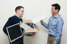 Two men collecting e waste computers for recycling © Zo Zhou