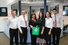 Todd Lipman, Roger Abbott, Tracey Ford, Sheree Middleton, Jo-Ann Youll and Michael Roberts from BEST Employment displaying one of the new green recycling bins installed in staff offices.