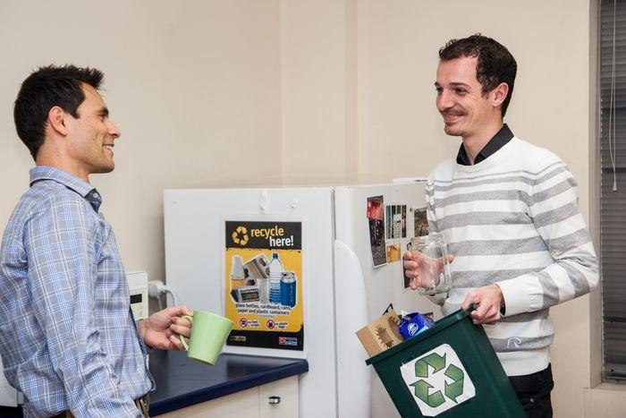 Two young men in the kitchen recycling with mixed bin © Zo Zhou
