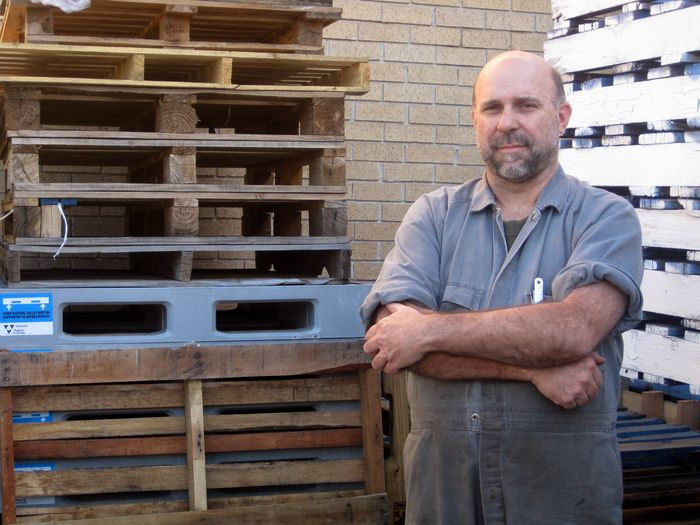 Small business owner and pallets © Planet Ark